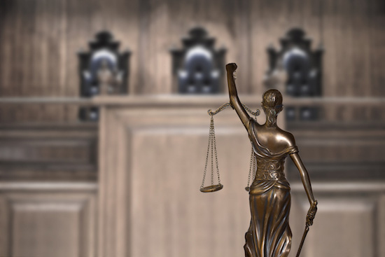 statue of woman holding the scale of justice