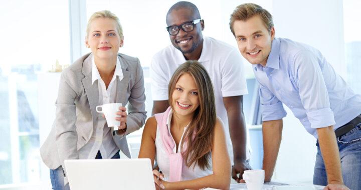 Employee at desk smiling